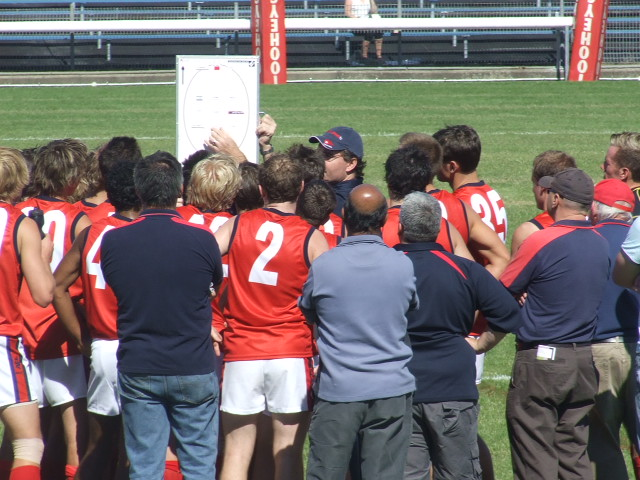 Mick Cousens and his Pennant Hills troops have a pep talk