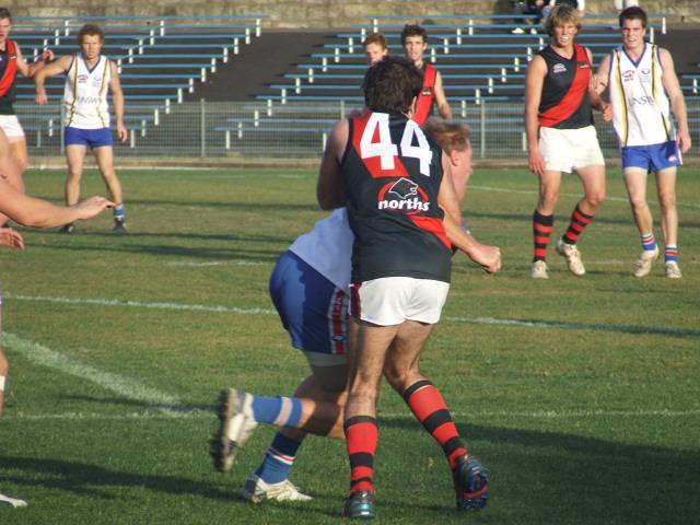 Ben Attwood applies a tackle