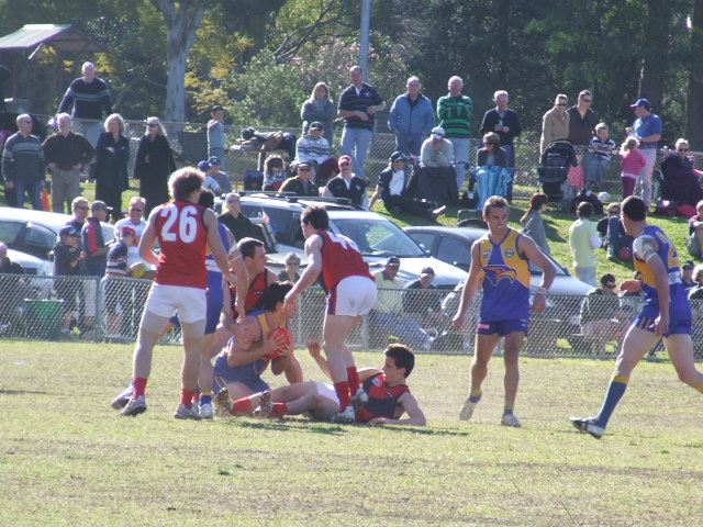 The Demons swarm to lay a tackle