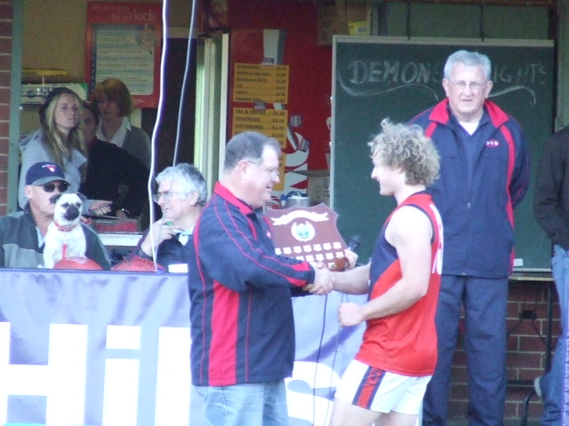 Charlie Richardson is presented with the Warren 'Pops' Quintrell Shield