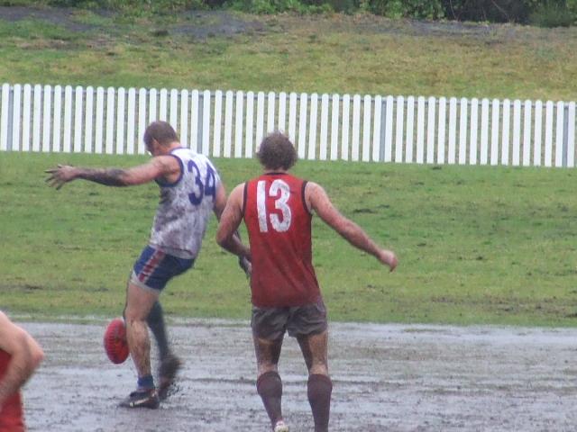 Troy Luff gets a kick away