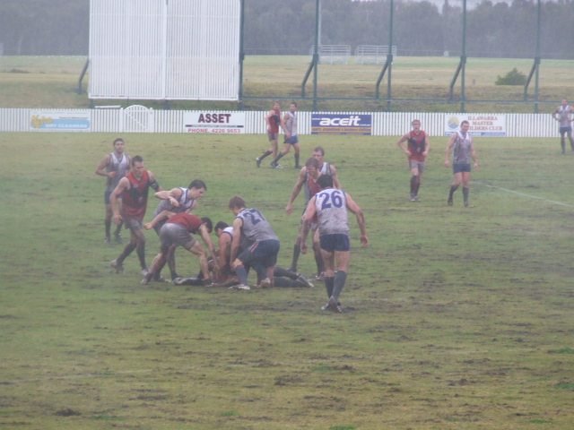 The pack forms on the half-forward line